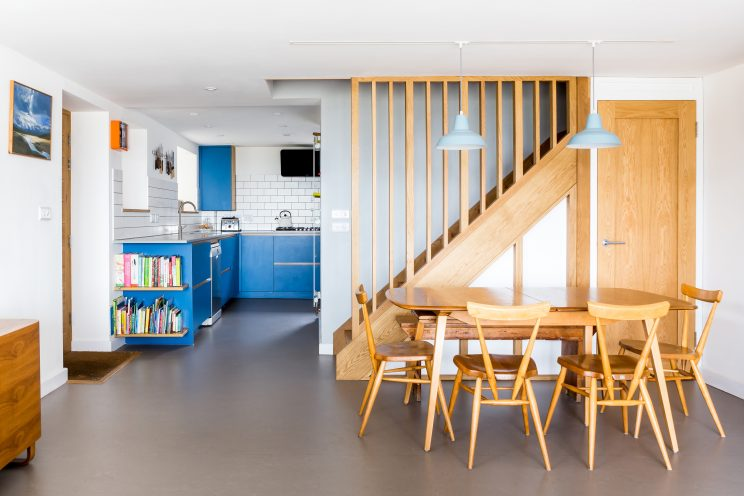 Blue modern kitchen with Scandi style living room