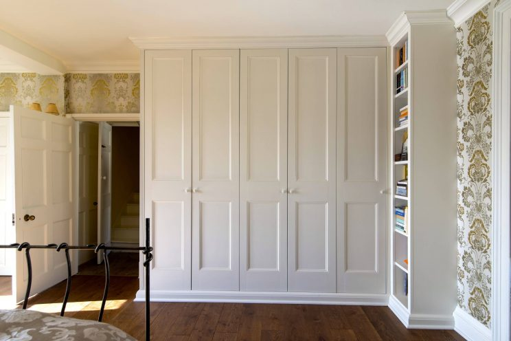 Traditional fitted wardrobe in bedroom