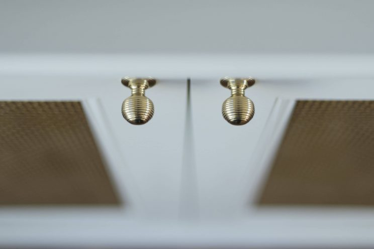 White cabinets with gold knob handles