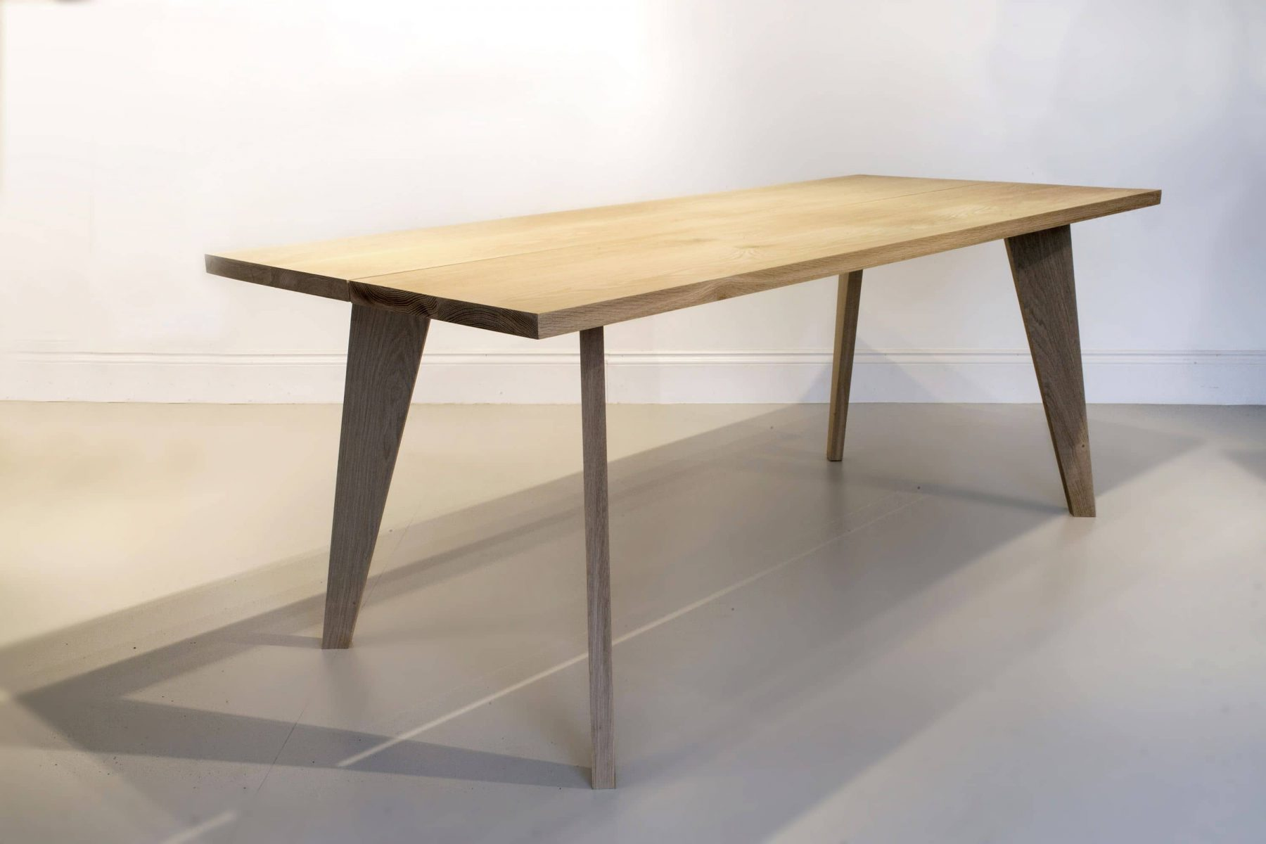 Wooden dining table with tapered legs