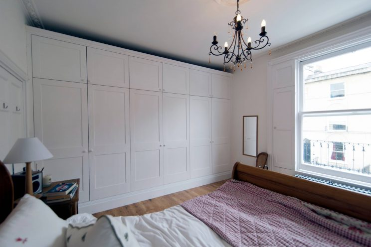 White fitted wardrobe in master bedroom