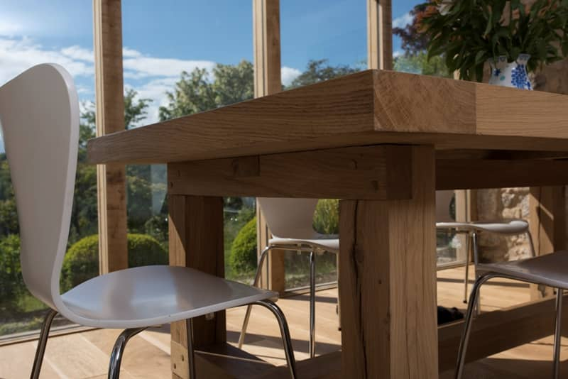 Bespoke oak table with contemporary white chairs