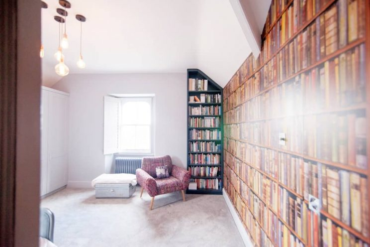 Freestanding bookcase in small library