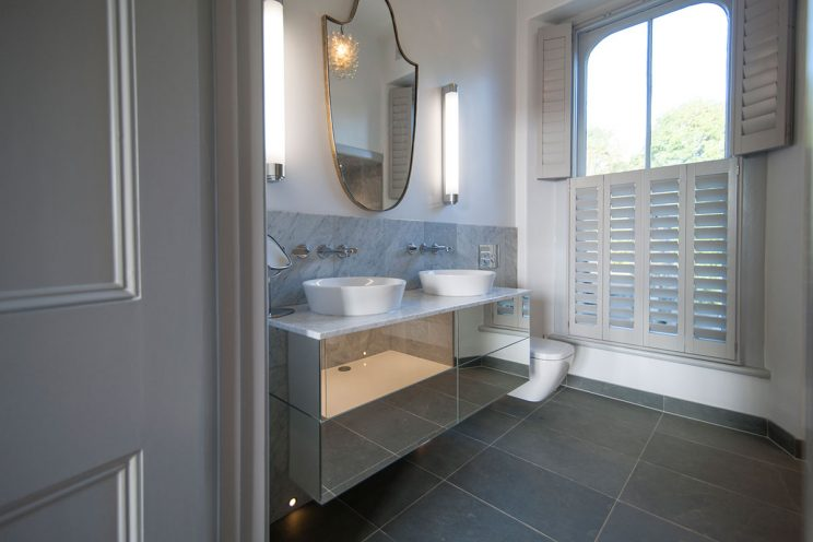 Bathroom mirror cabinets and wooden window shutters