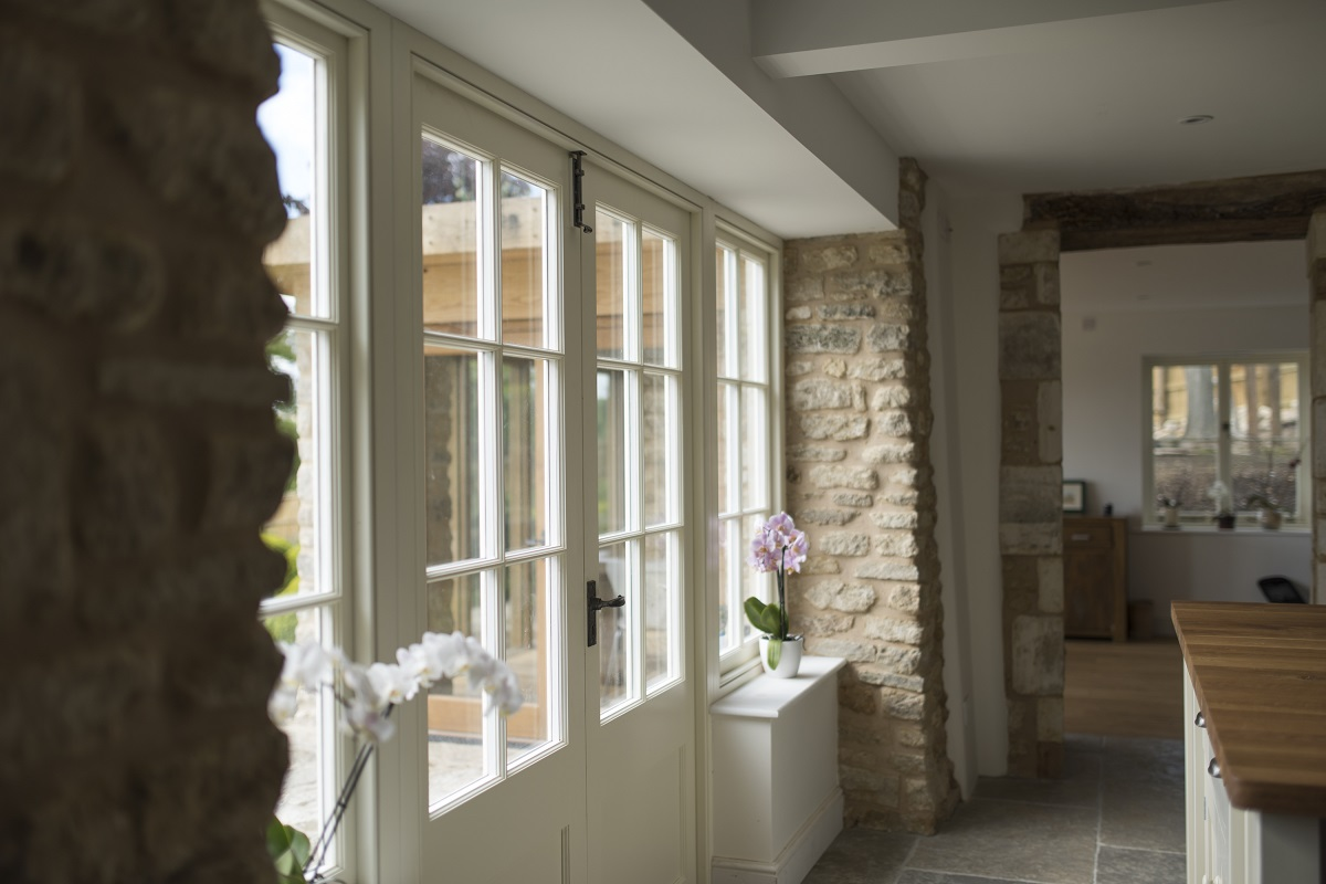 Cream french doors in country home