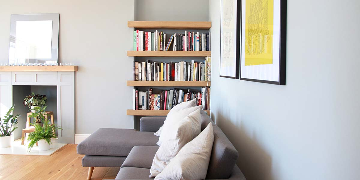 Contemporary living room in Bath with oak bookcase