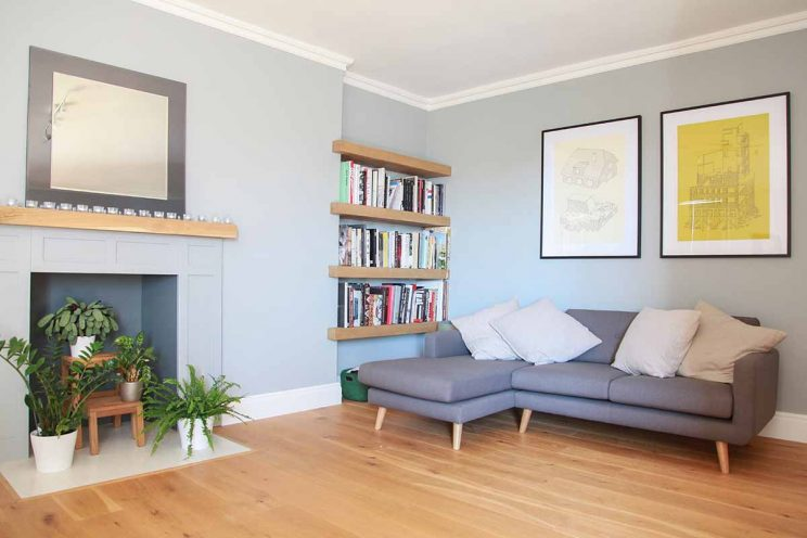 Contemporary living room in Bath with oak bookcase and flooring
