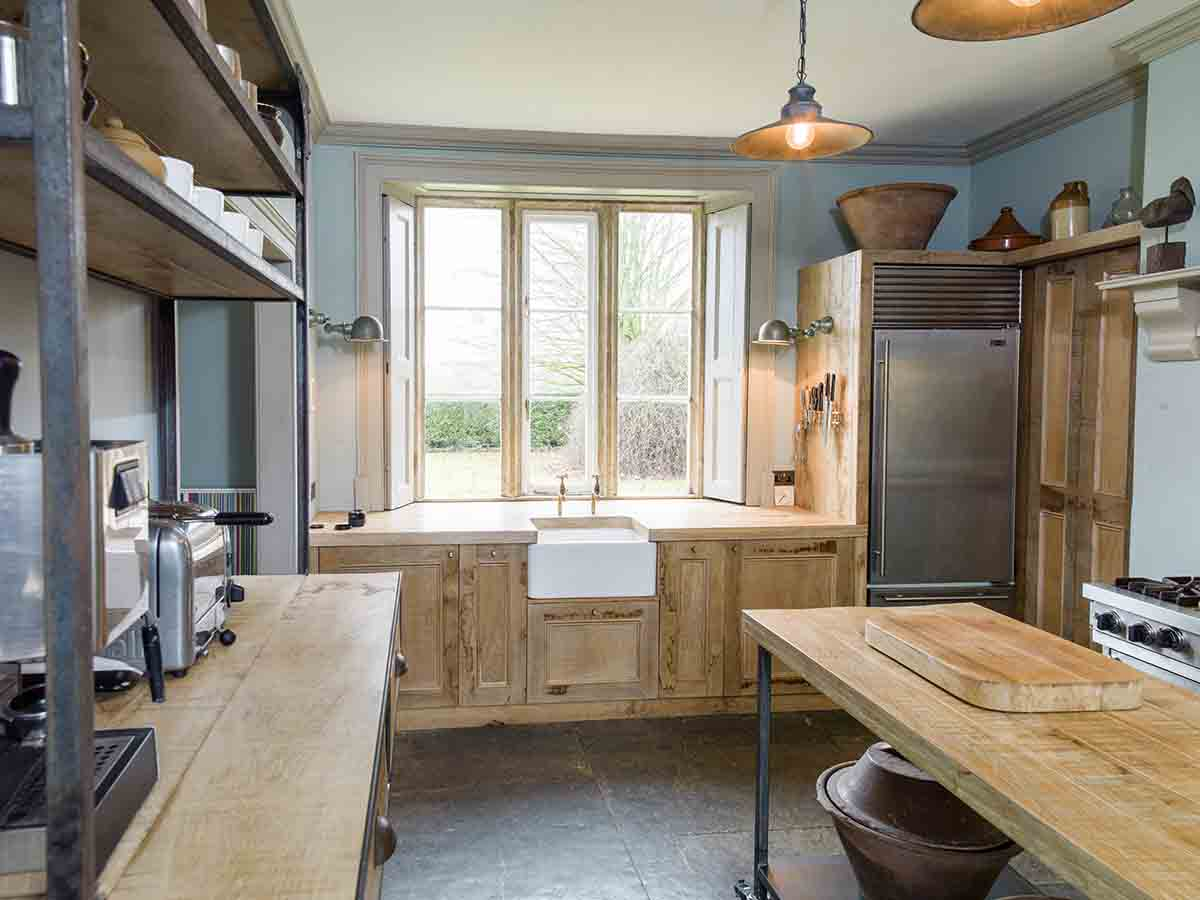 French chic kitchen with reclaimed oak cabinets designed by Mia Marquez