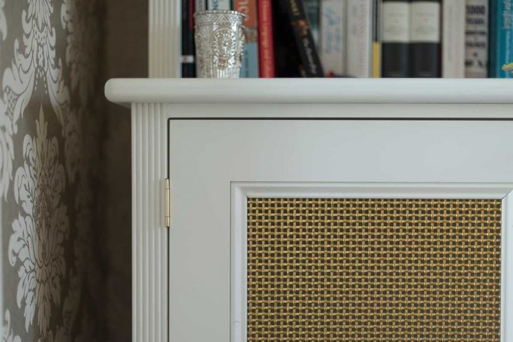 Vintage style white cabinet with gold grille
