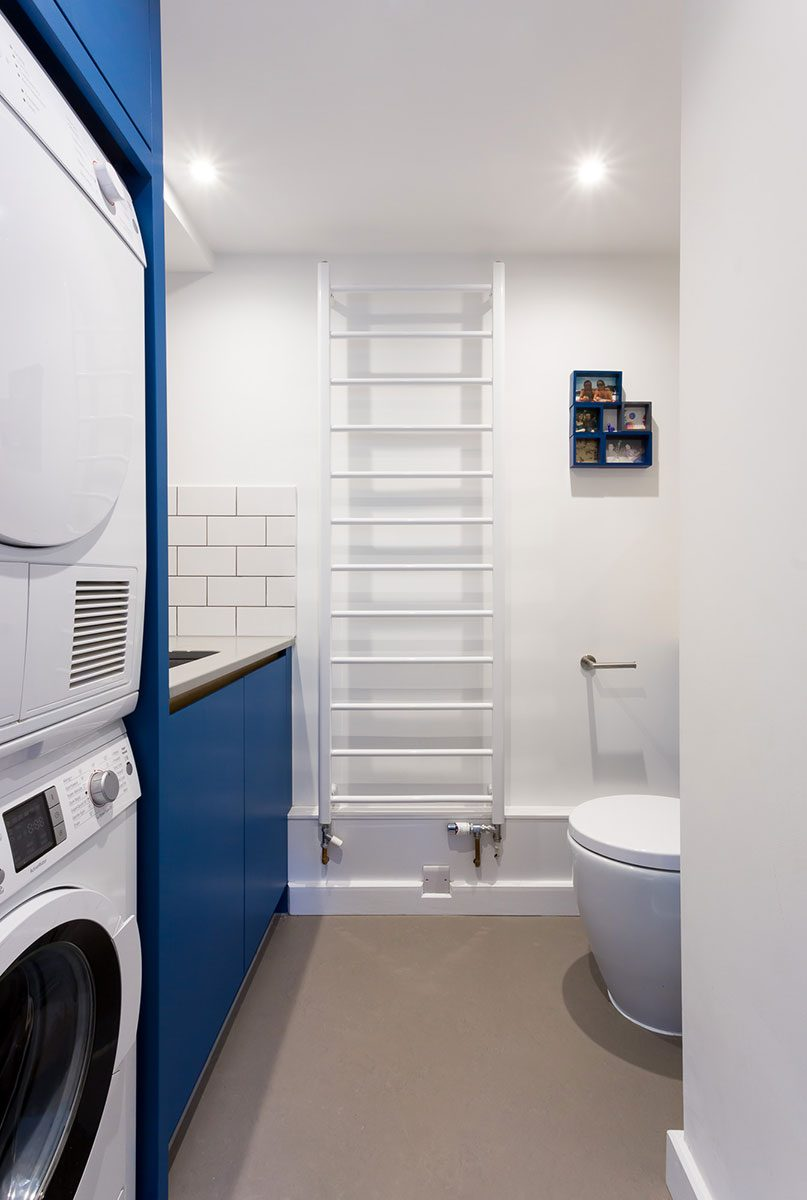 Double tier washing machine and dryer in galley shaped utility room