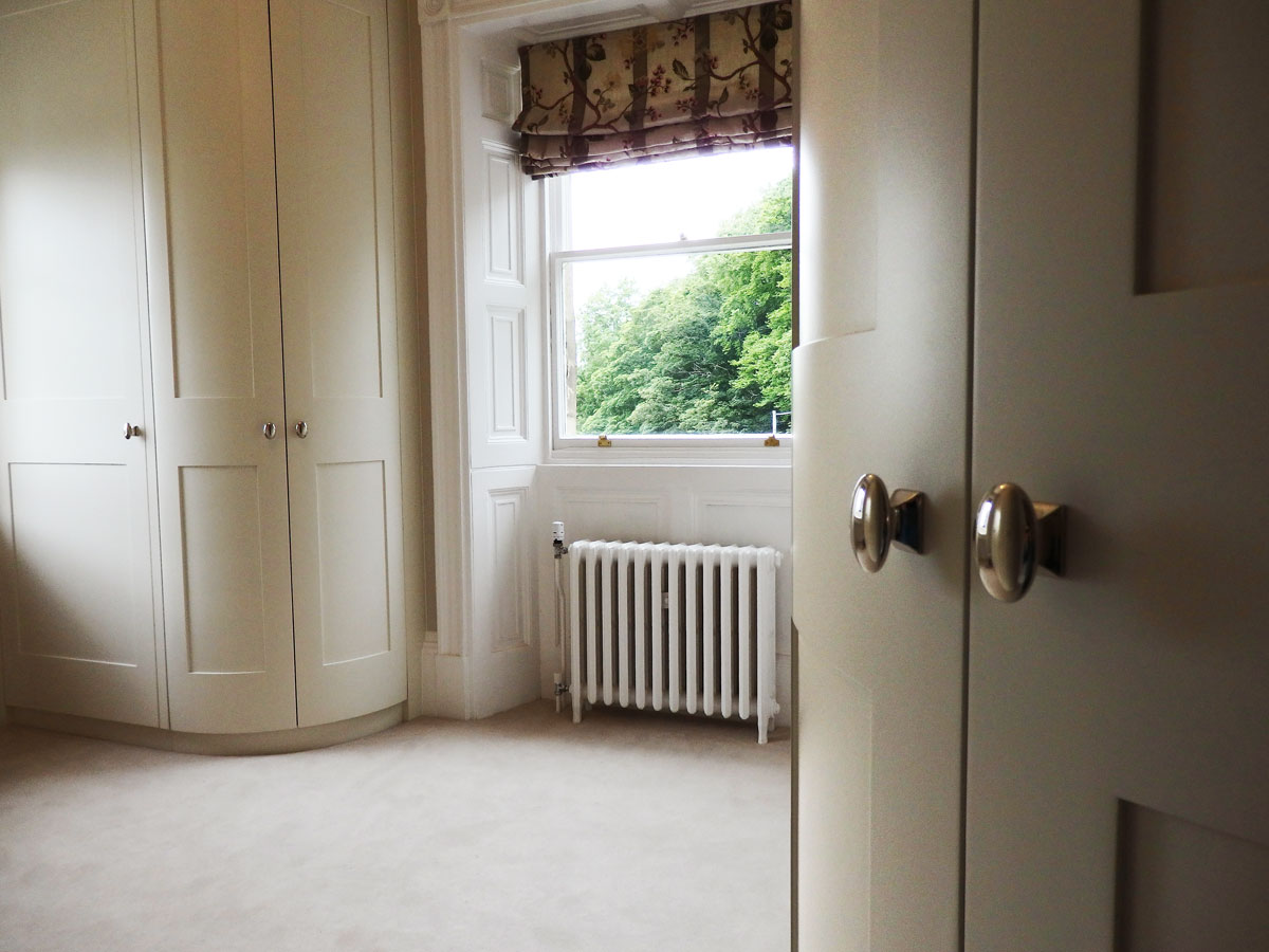 Curved wardrobes in bedroom