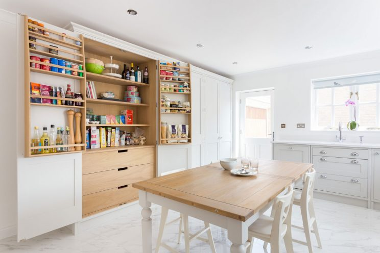 Contemporary white Shaker kitchen in Bath with large larders