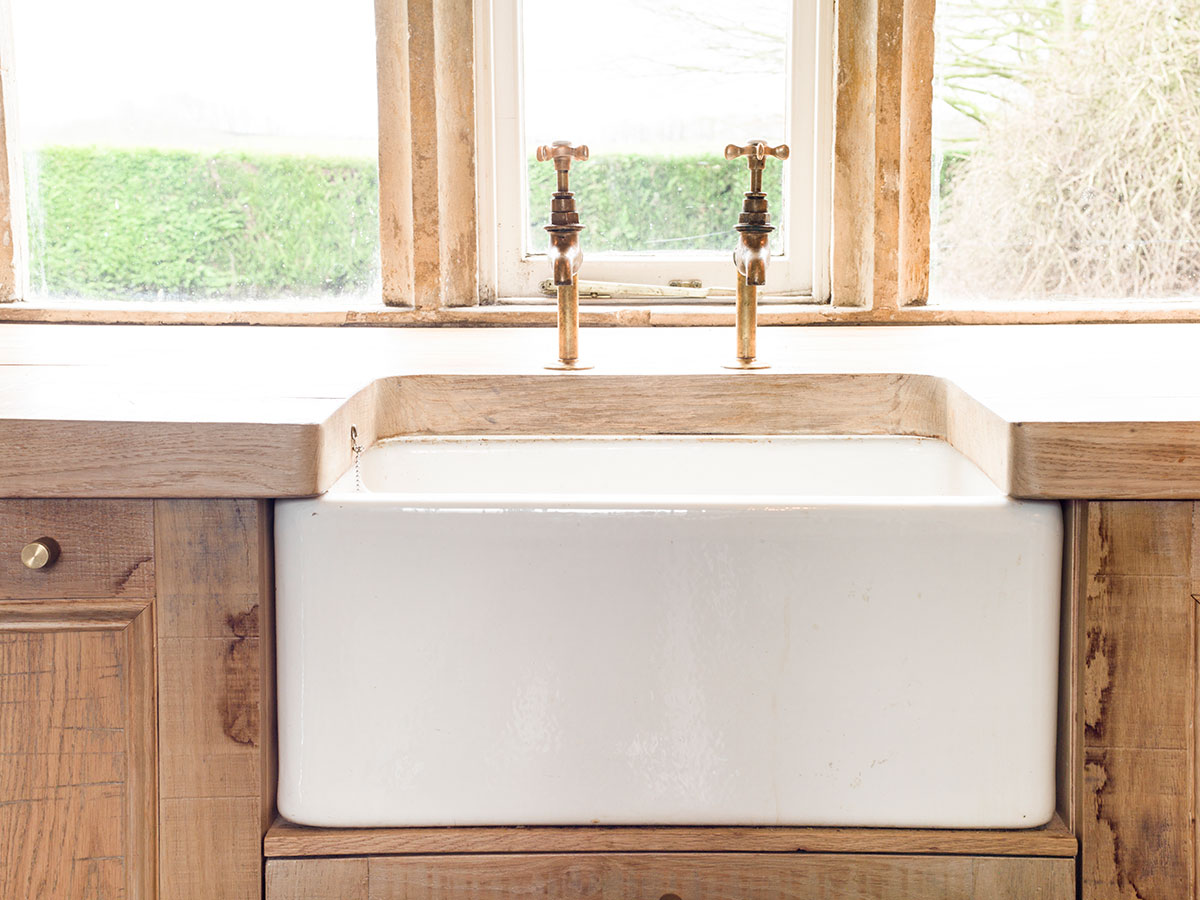 Rustic kitchen with butler sink designed by Mia Marquez