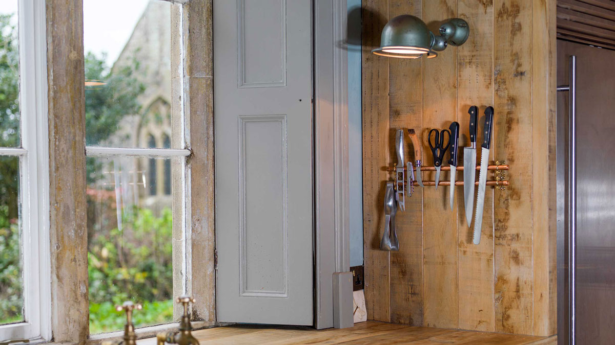Rustic kitchen with knife rack designed by Mia Marquez