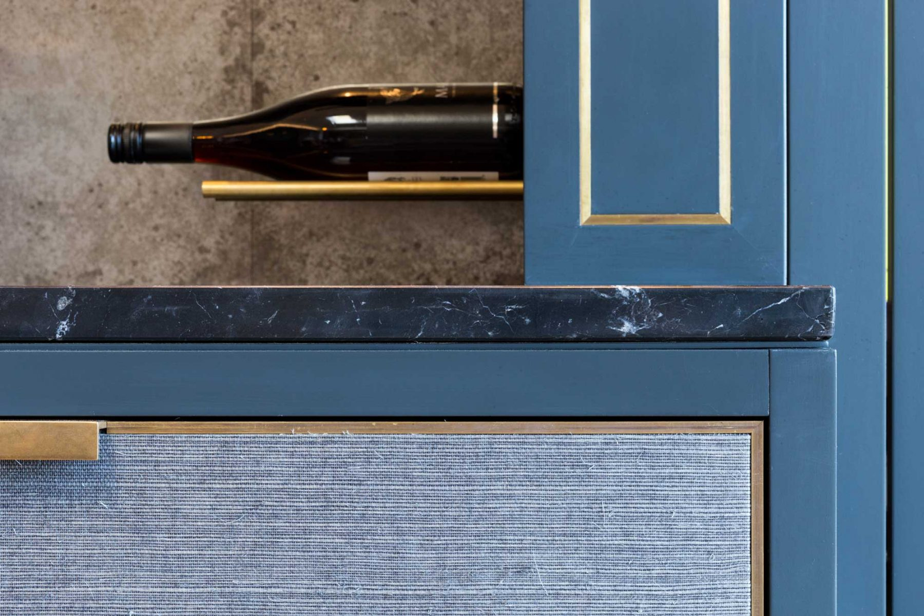 Wine wall with marble top and brass inlay