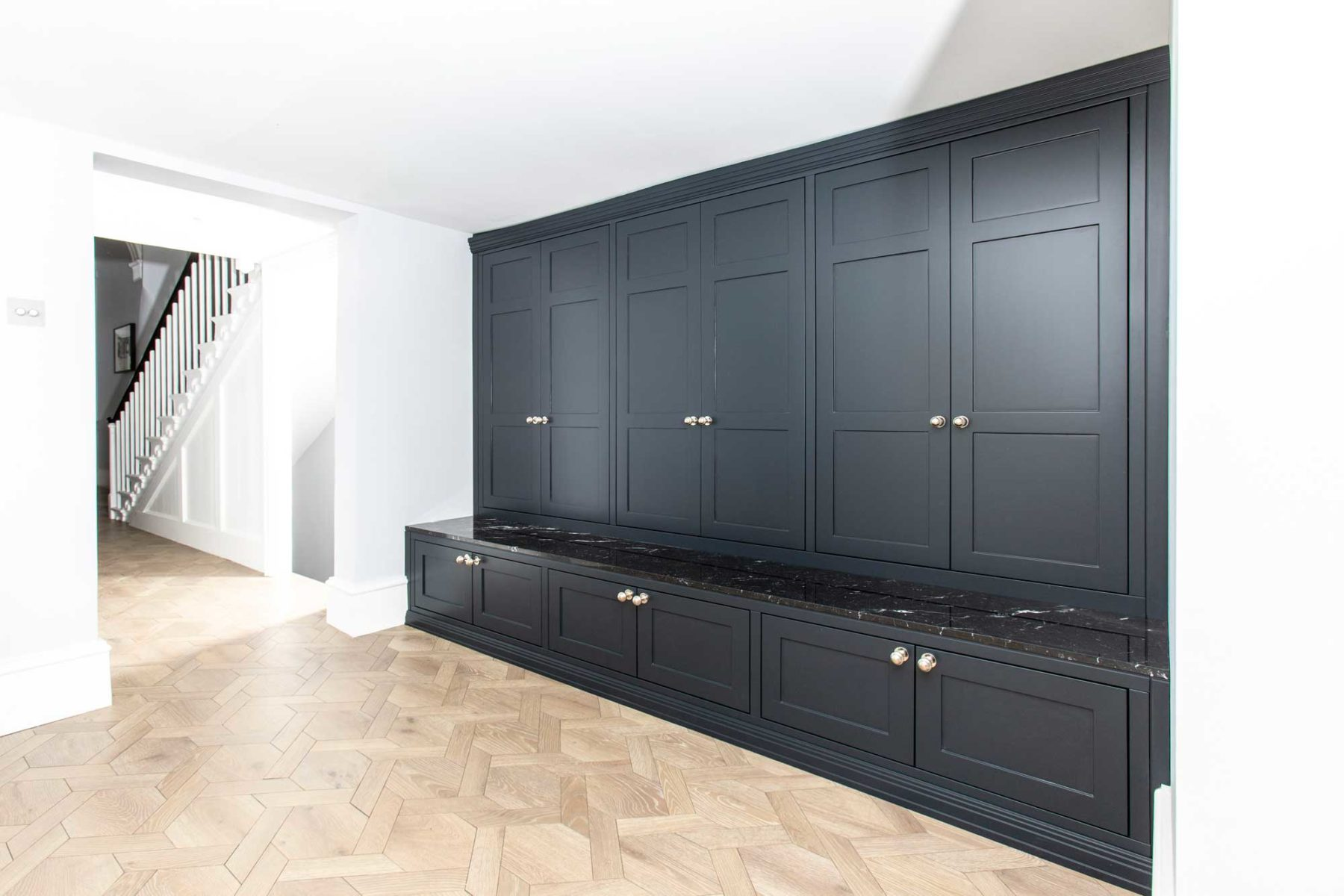 Boot room with Nero Marquina marble top