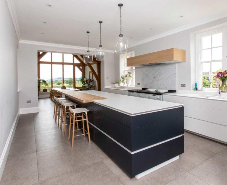 Modern white and blue kitchen with oak orangery