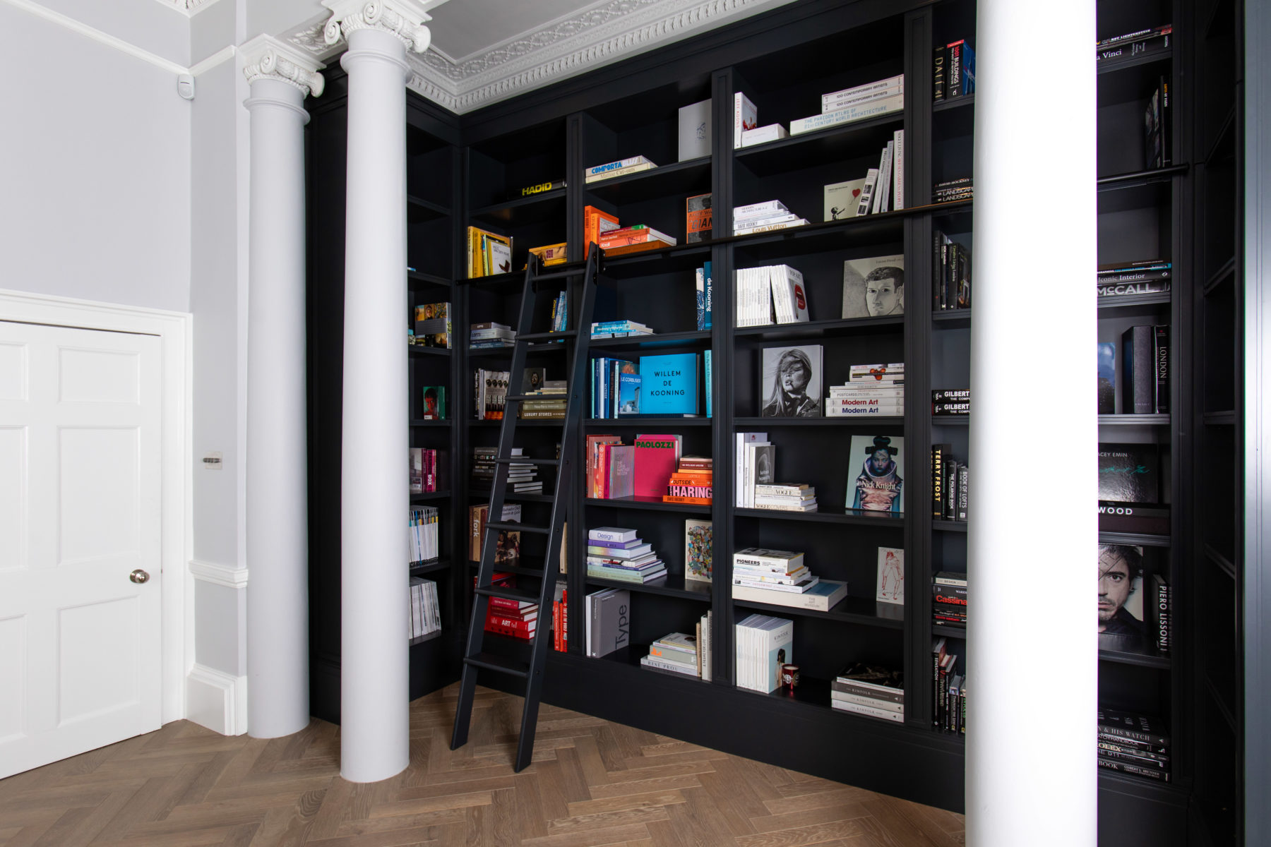 Bespoke, built-in library bookcase with ladder