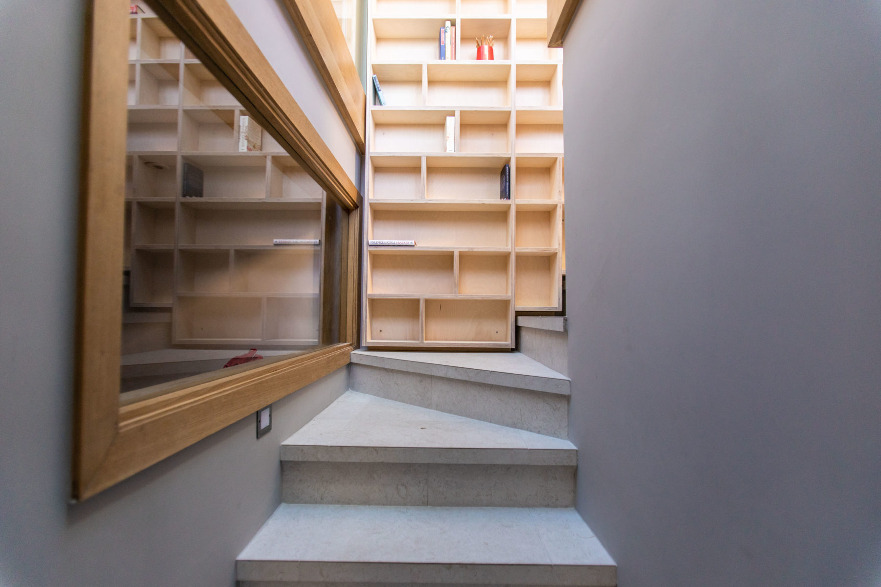 Library bookcase on stairway