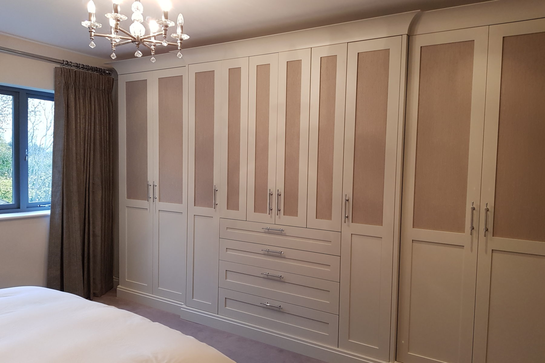 Bedroom wardrobes with pale pink panelled doors